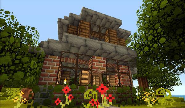 Imagen donde podemos ver una casa con jardín, decoradas con el paquete de texturas Good Morning Craft Texture Pack 1.9.