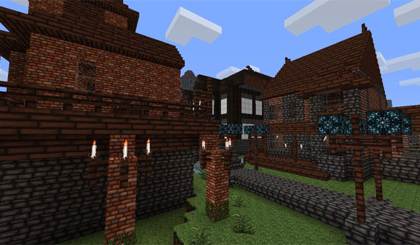 imagen de dos casas divididas por un camino, todo ello usando las texturas wolfhound 1.12 y 1.11.