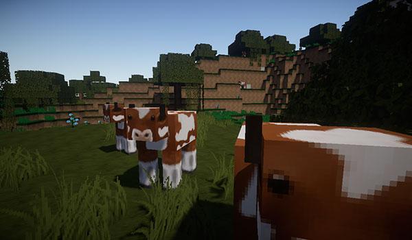 imagen donde vemos el aspecto del terreno y de las vacas, usando el paquete de texturas flows hd 1.11 y 1.10