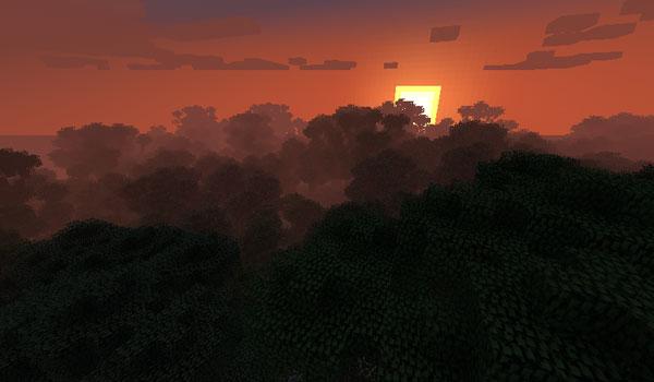imagen de un atardecer, donde vemos el sol caer sobre la copa de los árboles, en el mod bigtrees 1.7.2 y 1.7.10.