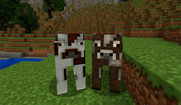 imagen donde vemos dos vacas, decoradas con las texturas default hd 1.8.