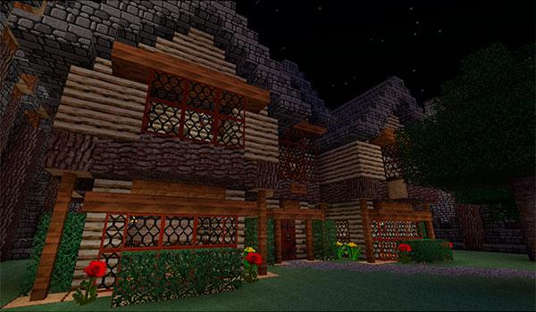 imagen del exterior de dos casas decoradas con las texturas del pack darklands classic 1.10 y 1.9.