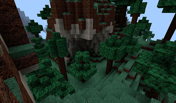 imagen de un paisaje donde vemos el aspecto de bloques de tierra, piedra y árboles.