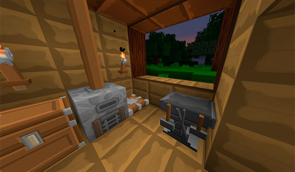 imagen donde vemos un cofre, un horno y una mesa de crafteo en el interior de una vivienda de Minecraft.