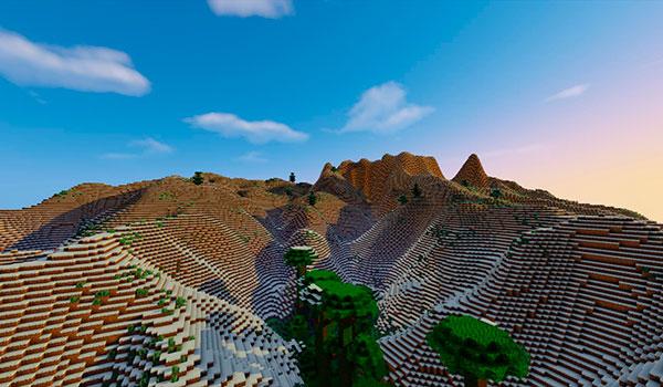 imagen donde vemos un paisaje de montañas nevadas en Minecraft.