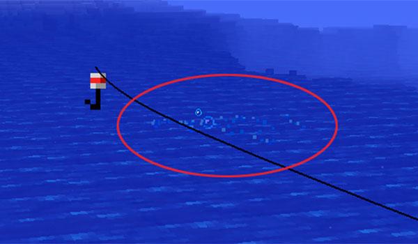 imagen donde vemos un grupo de burbujas acercándose al anzuelo, en este momento debemos tirar de la caña de pescar, para conseguir el pez.