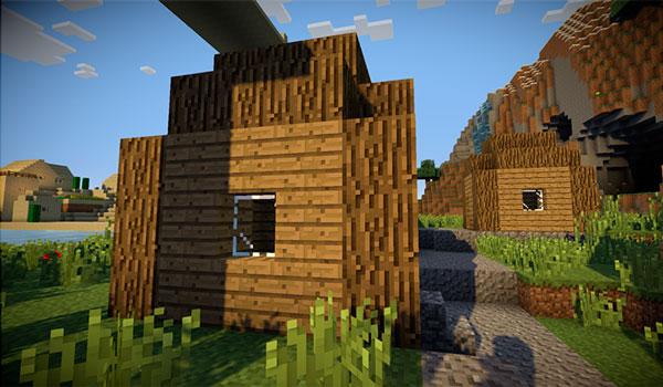 Imagen donde podemos ver el aspecto de los edificios de un poblado de Minecraft, utilizando el paquete de texturas bitbetter 1.12 y 1.11.