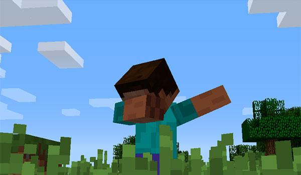 """Imagen donde vemos, en primer plano, a un jugador de Minecraft realizando el paso de baile conocido como """"Dab"""", gracias al mod dab 1.12, 1.12.1 y 1.12.2."""
