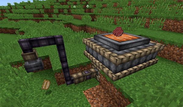 Imagen donde vemos una de las nuevas propuestas que nos ofrece el mod Embers 1.12.2 para cocinar grandes cantidades de comida al mismo tiempo.