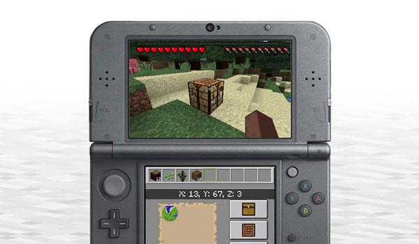 Imagen de ejemplo donde vemos una New Nintendo 3DS, con sus dos pantallas, ejecutando el juego de Minecraft.