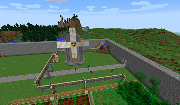 Imagen donde podemos ver una fortificación, en el interior de la cual se encuentra un molino de viento, creado con el mod Ancient Warfare 1.12.2.