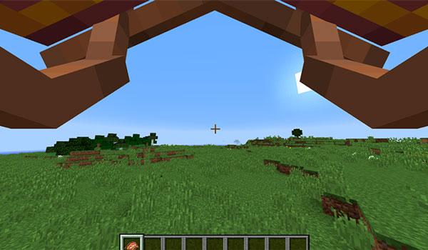Imagen, en primera persona, de un jugador utilizando el paracaídas que nos ofrece el mod Paragliders 1.12.2.