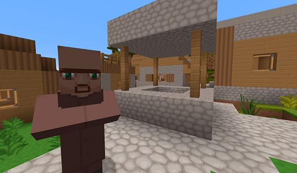 Imagen donde podemos ver el aspecto que tiene un aldeano, junto al pozo de una aldea, utilizando las texturas del paquete MetalTxus Uncertainty 1.17, 1.16 y 1.12.