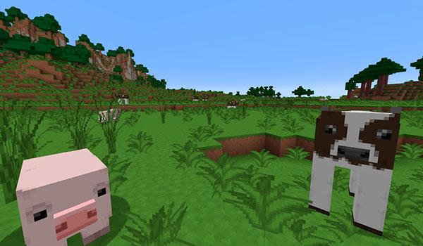Imagen donde podemos ver un cerdo y una vaca, además de un paisaje de montañas, utilizando el paquete de texturas MetalTxus Uncertainty 1.17, 1.16 y 1.12.