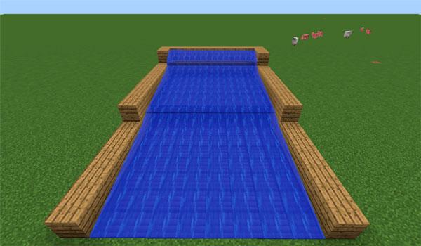 Imagen donde podemos ver una recreación de una corriente de agua, con las compuertas que añade el mod Gold In Them Thar Hills 1.12.2 para atrapar pepitas de oro.