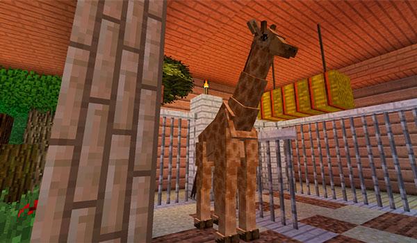 Imagen donde podemos ver a una de las jirafas que añade el mod Zoocraft Discoveries 1.12.2, dentro de un recinto cerrado.