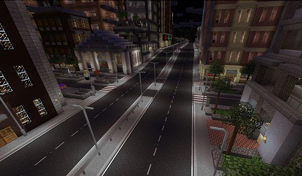 Imagen donde podemos ver una carretera de dos carriles para cada sentido, con farolas, vallas y señales de tránsito, creada a partir de los bloques y objetos del mod Fureniku's Roads 1.12.2.