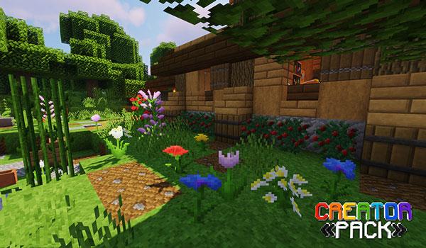 Imagen donde podemos ver una casa y su jardín, utilizando las texturas que ofrece el paquete de texturas The CreatorPack 1.15 y 1.14.