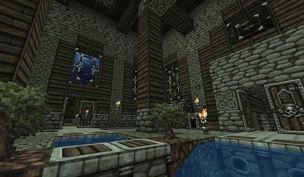 Imagen donde podemos ver el aspecto que tiene el interior de una construcción de piedra y madera, utilizando el paquete de texturas DokuCraft 1.14 y 1.13.