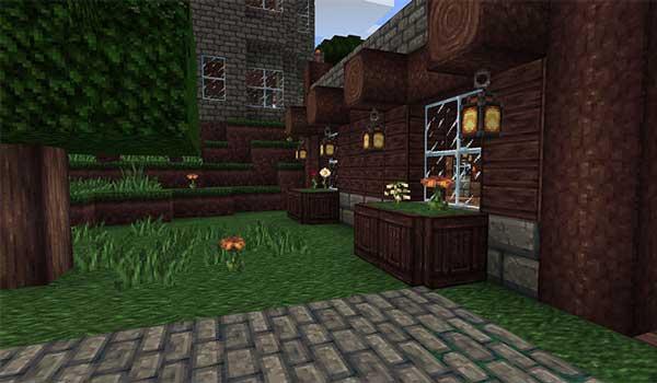 Imagen donde podemos ver el exterior de una casa, decorada con las texturas que nos ofrece Mythic 1.16, 1.15 y 1.14.