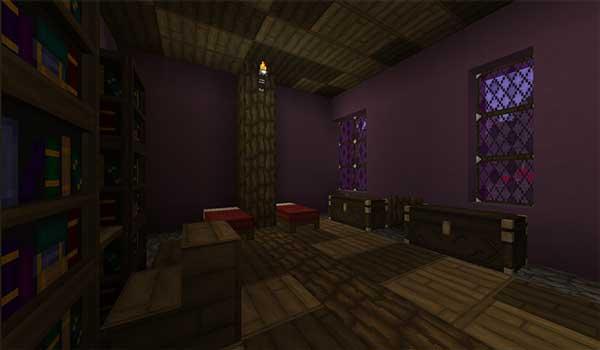 Imagen donde podemos ver el interior de una vivienda, con una librería, dos camas y dos cofres. Todo ello decorado con las texturas que ofrece Majestica Texture Pack 1.16, 1.15 y 1.14.