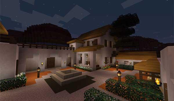 Imagen donde podemos ver el jardín de una gran parcela, con una casa, decorado con las texturas del paquete de texturas Medial 1.16, 1.15 y 1.14.