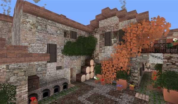 Imagen donde podemos ver una casa con un patio interior, decorado con las texturas que ofrece Italiapack 1.15 y 1.14.