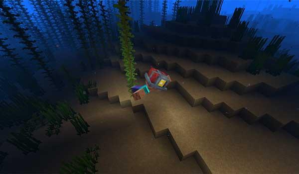 Imagen donde vemos un jugador explorando el suelo marino con el casco que ofrece el mod Miner's Helmet 1.16.1.