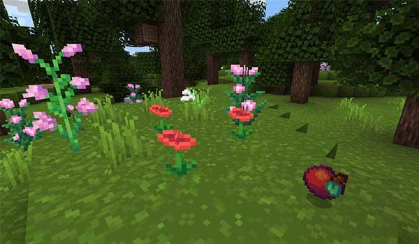 Imagen donde podemos ver un paisaje de un prado con árboles, todo ello decorado con las texturas de CraftMania Texture Pack 1.16, 1.15 y 1.14.