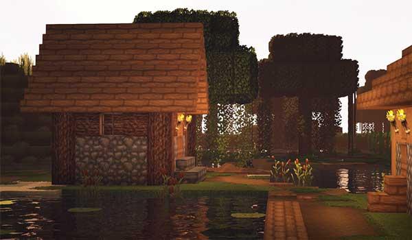Imagen donde podemos ver el paisaje de una aldea, decorada con las texturas Overgrowth 1.16, 1.15 y 1.14.