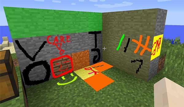 Imagen donde podemos ver a un jugador dibujando, y pintando, sobre bloques de Minecraft, gracias a las funcionalidades que ofrece el mod MC Paint 1.16.1 y 1.16.3.
