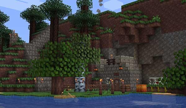 Imagen donde podemos ver una casa, al lado de un lago, decorada con el paquete de texturas Perch 1.16 y 1.15.
