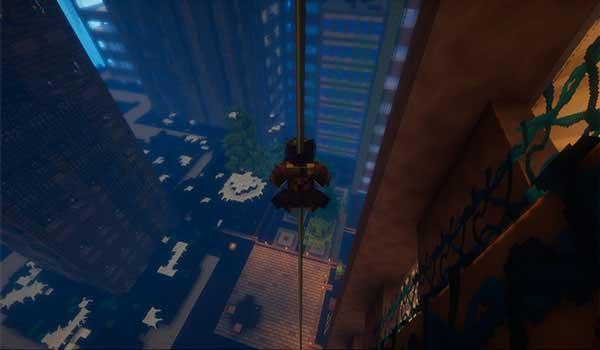 Imagen donde podemos ver un jugador descendiendo por una de las barras de hierro que nos permitirá crear el mod To the Bat Poles 1.16.1, 1.16.2, 1.16.3 y 1.16.4.