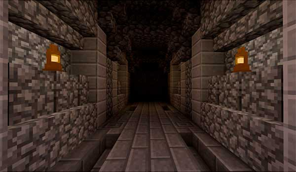 Imagen donde podemos ver dos lámparas iluminando un pasillo subterráneo, gracias a las lámparas que ofrece el mod Lantern 1.16.4.