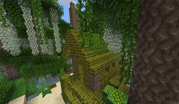 Imagen donde podemos ver una de las casas de madera de ciprés que podremos encontrar en el nuevo bioma que añade el mod Bayou Blues Mod 1.16.4 y 1.16.5.