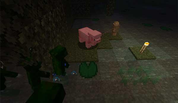 Imagen donde podemos ver un grupo de ranas humanoides, del mod Froglins 1.16.3, 1.16.4 y 1.16.5, dirigiéndose a un cerdo.