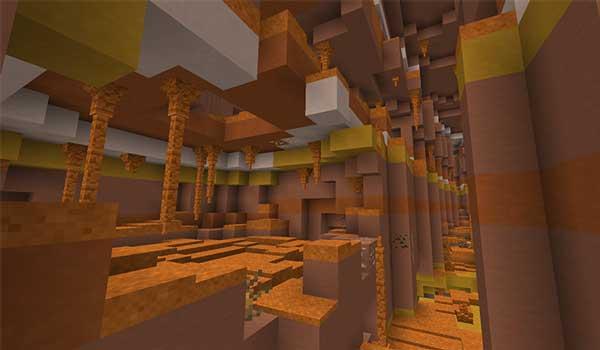 Imagen donde podemos ver el interior de una cueva, en el bioma Mesa, generada por el mod Subterranean Wilderness 1.16.3, 1.16.4 y 1.16.5.
