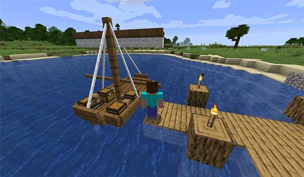 Imagen donde podemos ver un jugador, en un puerto, junto a uno de los barcos que podremos construir con el mod Small Ships 1.16.3, 1.16.4 y 1.16.5.