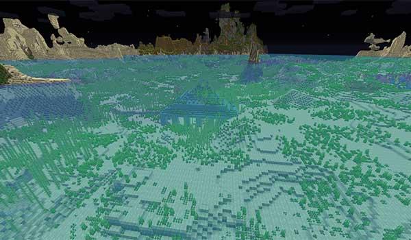 Imagen donde podemos ver, de noche, un monumento oceánico gracias al paquete de texturas Night Vision Texture Pack.