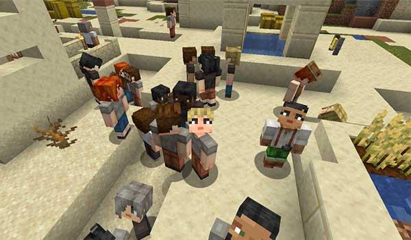 Imagen donde podemos ver un grupo de aldeanos, deambulando por una aldea del desierto, con las texturas generadas por Player Villager Models Texture Pack 1.16, 1.15 y 1.12.