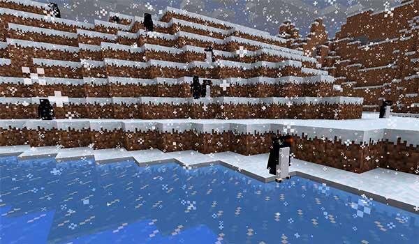 Imagen donde podemos ver un grupo de pingüinos, del mod Waddles 1.17.1, deambulando bajo una tormenta de nieve.